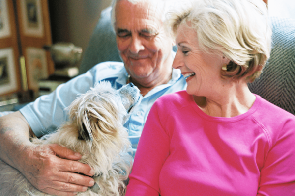 senior couple on couch with dog hospice marketing agency raleigh nc