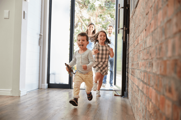 boy running into house real estate marketing raleigh nc